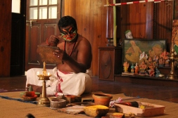 Kathakali actors applying their makeup